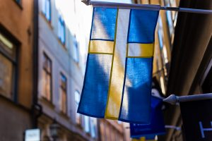 Swedish Flag hanging in an alley.