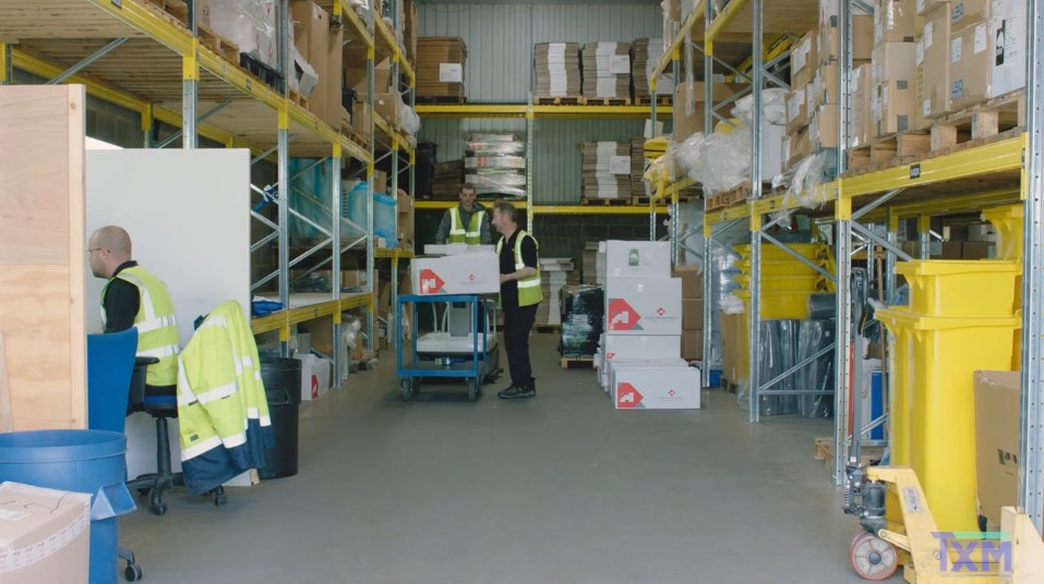men working in a warehouse unit
