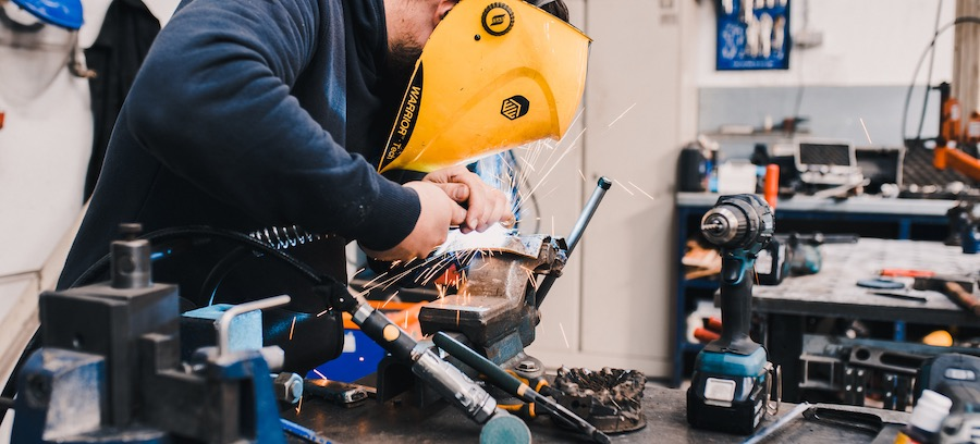 Worker customising metal products